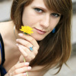 Portrait of a young beautiful girl with a dandelion flower — Stock Photo