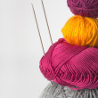Bright tangle of thread and knitting needle - Stock Photo