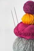 Bright tangle of thread and knitting needle — Stock Photo