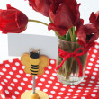 Bouquet of red tulips and clothespin with card for text - Stock Photo