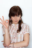 Portrait of a handsome young girl gesturing ok sign over — Stock Photo