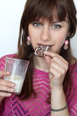 Young beautiful brunette eating delicious chocolate cookies — Stock Photo