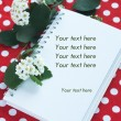 Notebook for notes and a branch with white flowers — Stock Photo