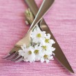 Fork, knife and a small bouquet of white flowers — Stock Photo