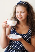 Beautiful young brunette holding a large cup — Stok fotoğraf