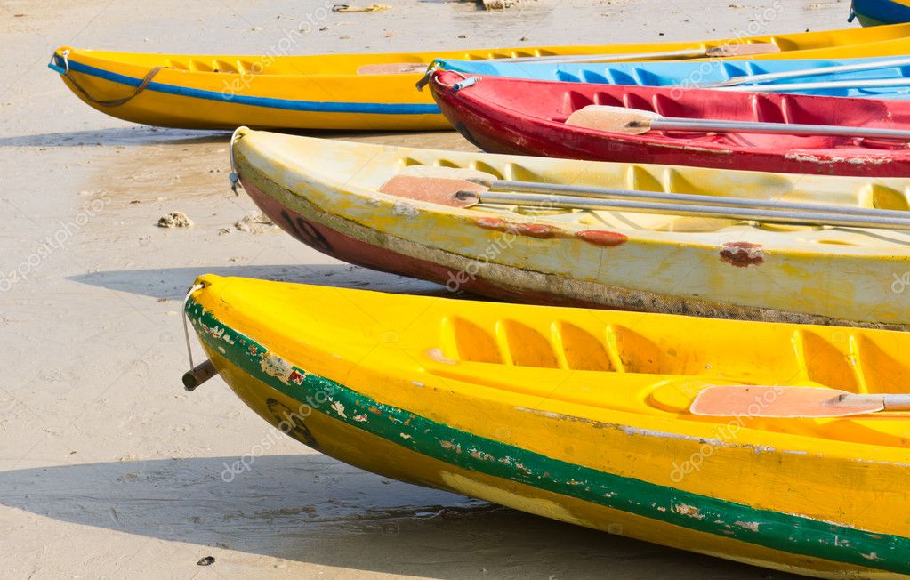 Old Colorful kayaks on the beach  Stock Photo #5981000