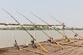 Fishing Poles on Pier — Stock Photo