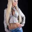 Beauty sexy blonde in leather jacket and jeans — Stock Photo #5523200