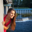 Stock Photo: Young beauty womin red smile and look at sunset