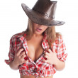 Sexy young cowgirl put hands on breast — Stok fotoğraf #5612972