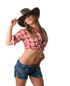 Sexy young cowgirl stand with naked stomach — Stock Photo