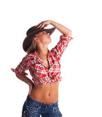 Sexy young cowgirl take hand on hat isolated — Stock Photo