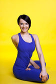 Beauty yong woman smile in lotos pose — Stock Photo