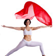 Woman stand in yoga asana and red flying fabric — Stock Photo