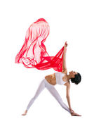 Woman exercise yoga asana and red flying fabric — Stock Photo