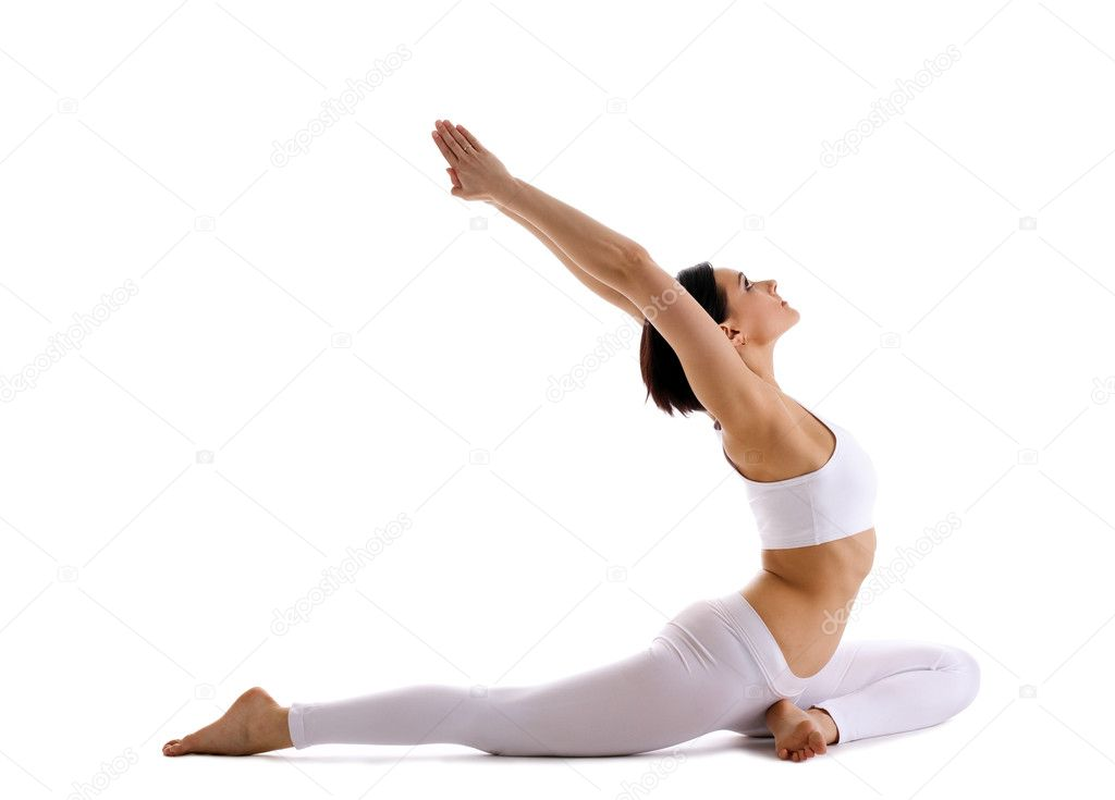 Young woman training in yoga asana - pigeon pose isolated — Stock Photo #5833857
