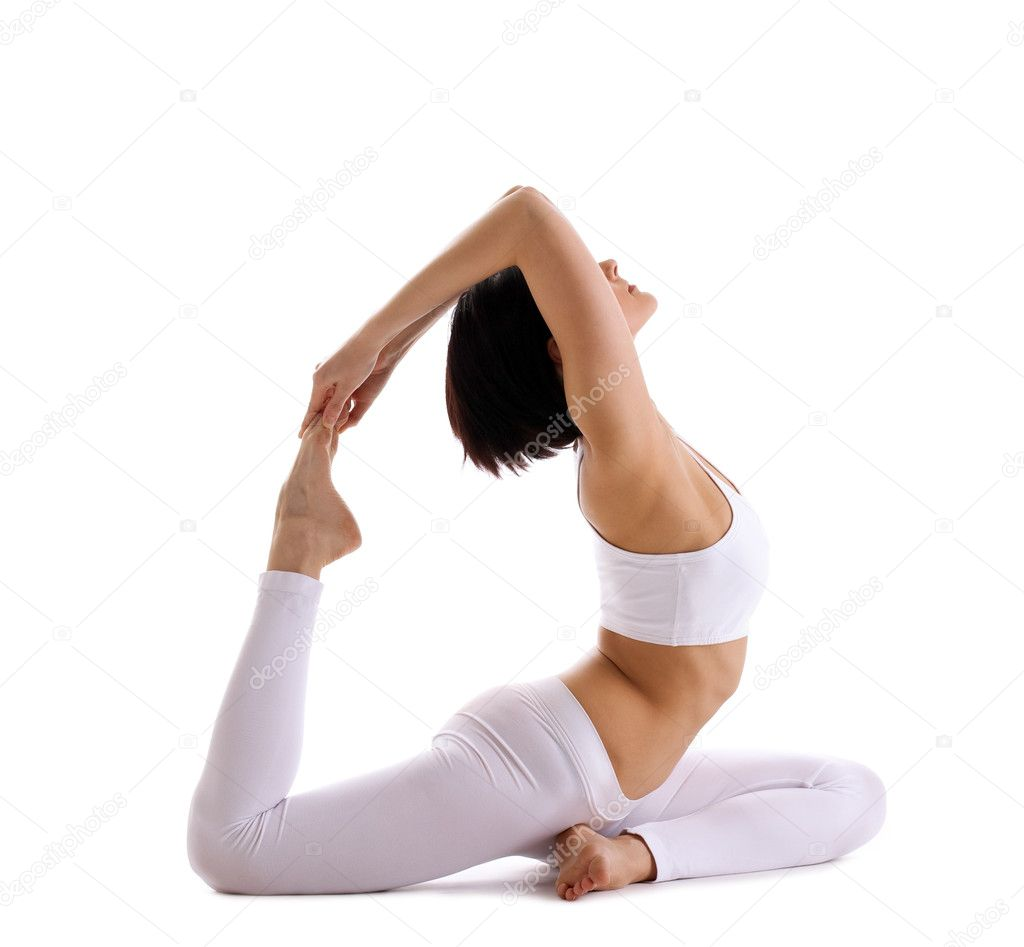 Young woman training in yoga asana - pigeon pose isolated — Stock Photo #5833859