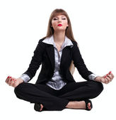 Yong business woman sit in yoga pose — Stock Photo
