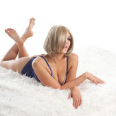 Beauty desired woman lay on fur in lingerie — Stock Photo