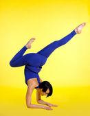 Woman exercise yoga pose asana - blue on yellow — Stock Photo