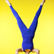 Beauty happy yoga master stand on head - Zdjęcie stockowe