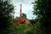 Pile rig repair bridge over rail road — Stock Photo