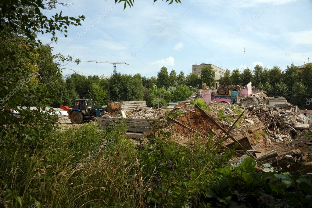 Tractor clear construction site from garbage at summer day — Stock Photo #6258763