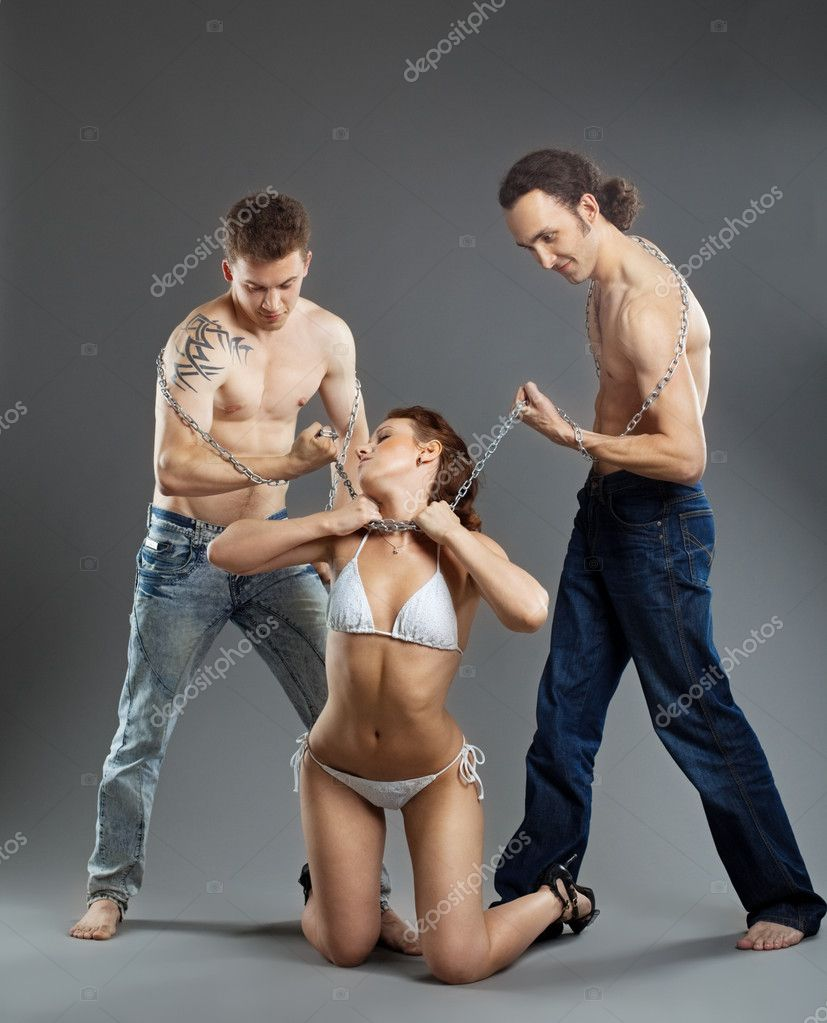 Two man take woman on chain in violence - bdsm games — Stock Photo #6566886