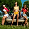 Three young woman pin-up style near retro car — Stock Photo