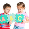 Boy and girl holding letters — Stock Photo #5609333