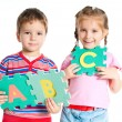 Boy and girl holding letters — Stok fotoğraf
