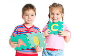 Boy and girl holding letters — Foto de Stock
