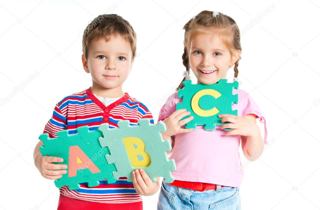 Boy and girl are holding colorful letters — Stock Photo #5741506
