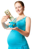 Pregnant woman with a piggy bank — Stock Photo