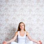 Young woman sitting yoga posture — Stock Photo #6095355