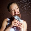 Pretty young girl eating chocolate — Stock Photo #6095368