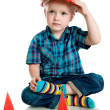 Little boy in a red construction helmet — Stock Photo #6095552