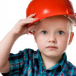 Little boy in a red construction helmet — Stock Photo