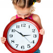 Little girl with clock - Stock Photo