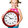 Little girl with clock — Stock Photo