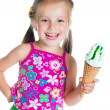 Cute little girl eating ice cream — Stockfoto