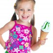 Cute little girl eating ice cream — ストック写真