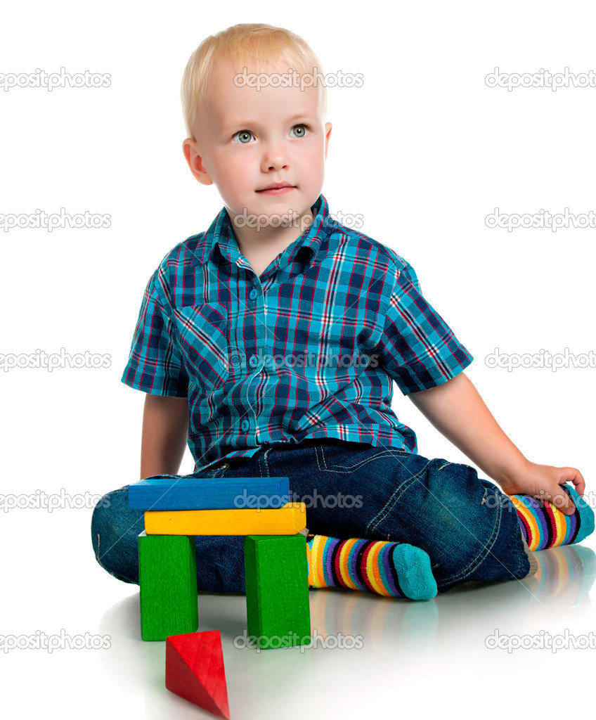Little boy playing with toys on a white background — Stock Photo #6095486