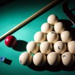 Royalty-Free Stock Photo: Billiard pyramid and cue on table.
