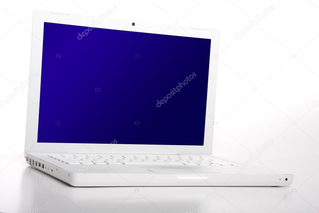 White laptop with blank blue screen. Clipping path on screen - easy paste your image into it.  Stock Photo #6579830