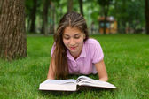 Young girl reading the book — Stock Photo