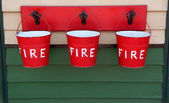 Three Red Fire Buckets — Stock Photo