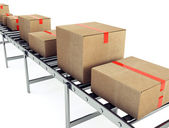 Cardboard boxes on conveyor belt — Stock Photo