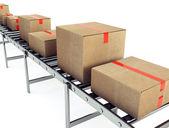 Cardboard boxes on conveyor belt — Stock Photo