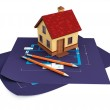 Blueprints and house — Stock Photo